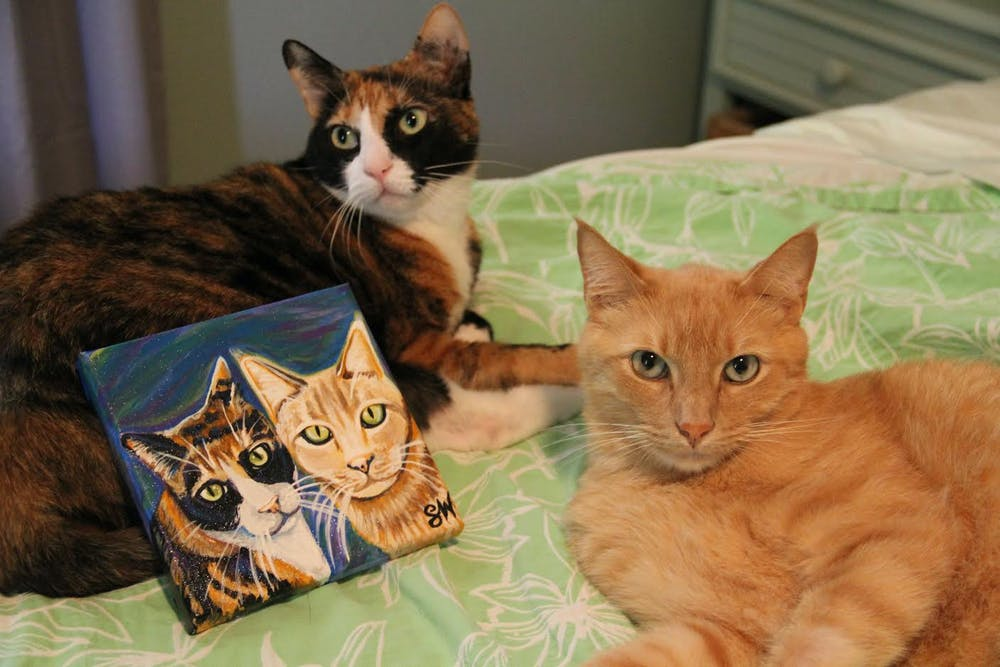 <p>Oka and Mango posing with their commissioned Samm Wehman Art Pet Portrait. (Courtesy by Samm Epstein)</p>