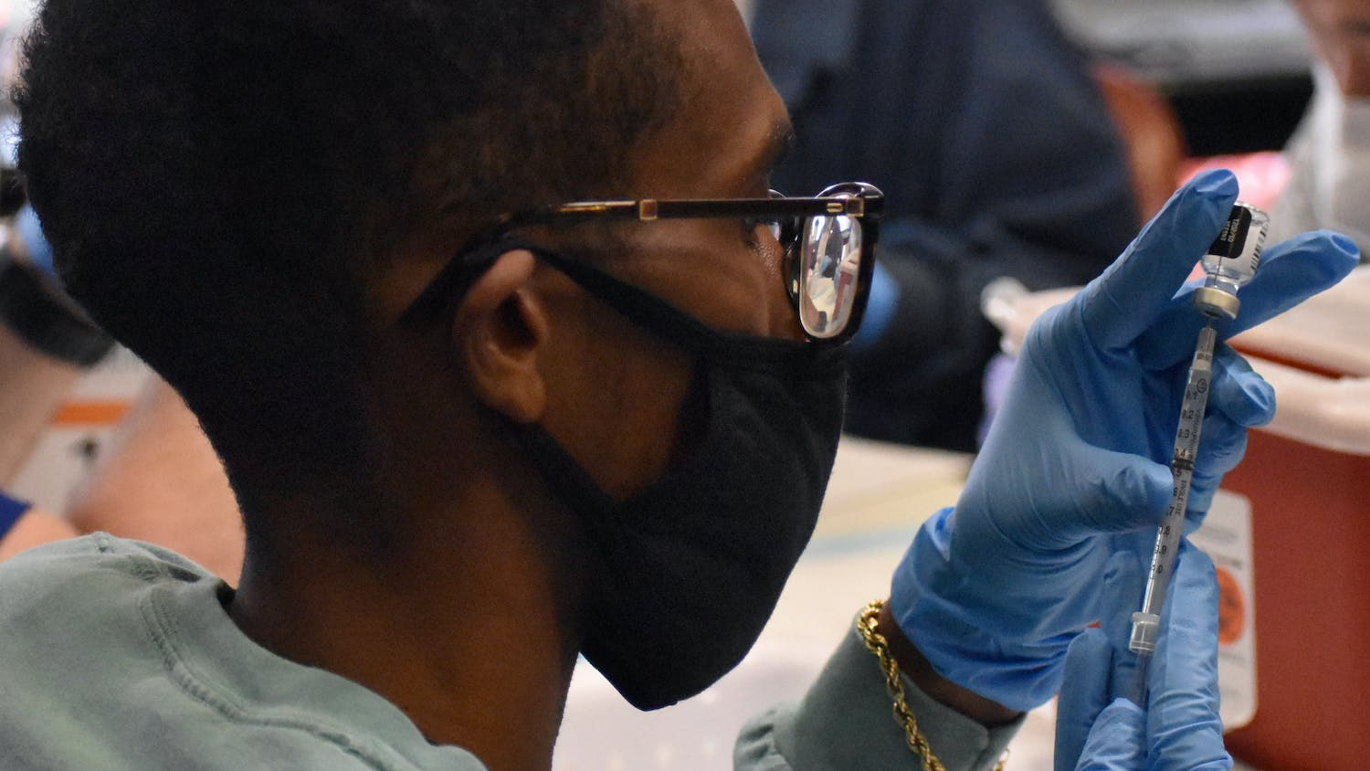 A UF pharmacy student prepares the COVID-19 vaccine before it is administered Friday, Feb.5, 2021.