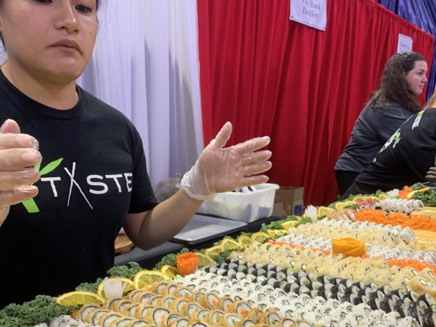 Taste of Greater Gainesville attendees samples sushi provided by Taste, a local restaurant that serves Pan-Asian cuisine.