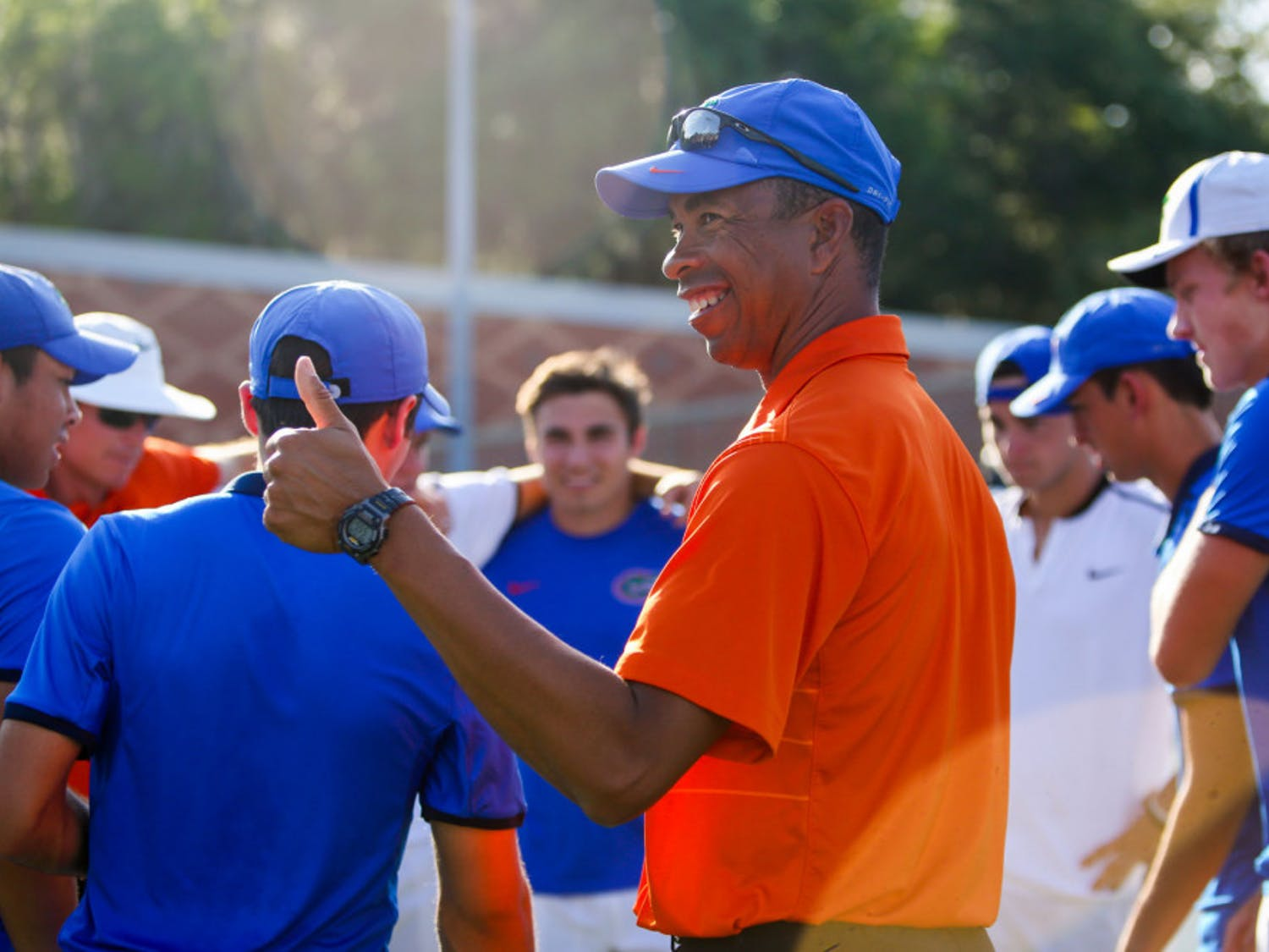 UF men's tennis coach Bryan Shelton joins his team after its Senior Day match with Alabama on April 13. The Gators went 19-10 on the season and qualified for the NCAA Tournament.