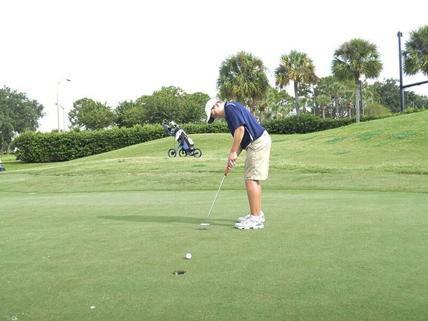 Joe Pagdin drains a putt for Trinity Prep in 2015, where he was the No. 1 player on the varsity team in eighth grade.