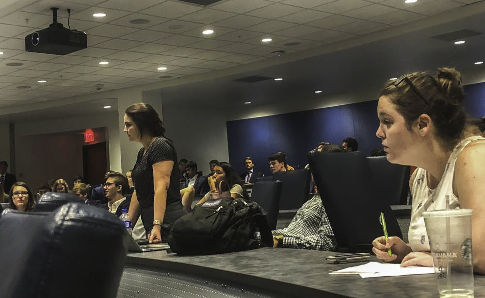 <p>Ashley Grabowski (left) at a May 25 Student Senate meeting. </p>