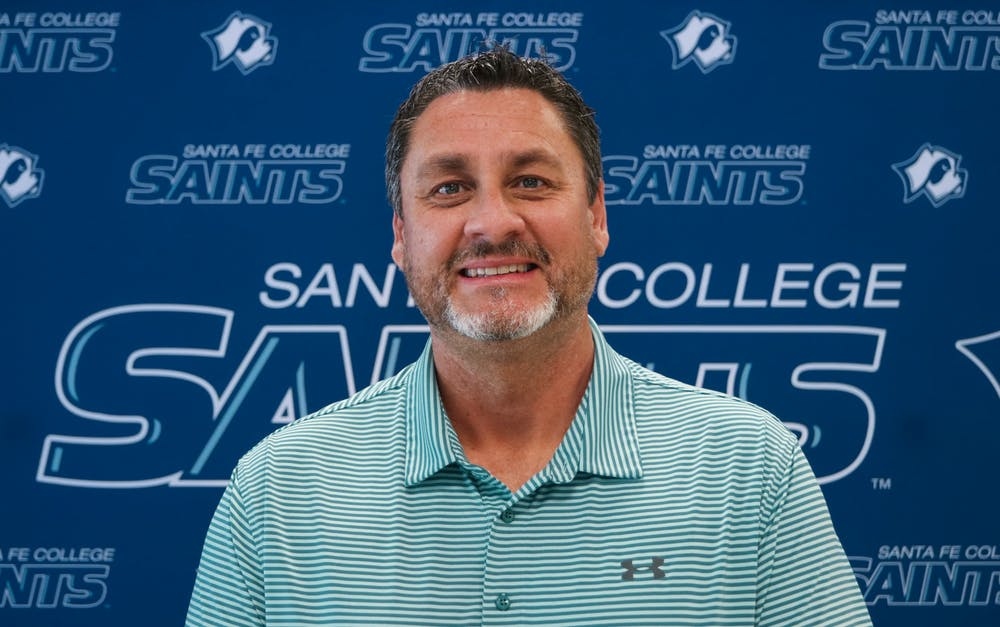 """Santa Fe College's new athletic director, Greg McVey, 51, poses inside the school's gym on Tuesday, June 1, 2021. McVey, who hails from the Midwest, said he's looking forward to working with """"great people"""" and """"great student athletes."""