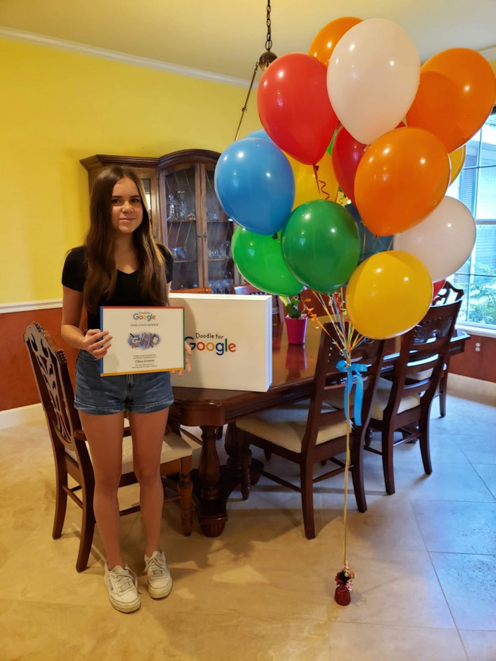"""<p><span id=""""docs-internal-guid-8542ae33-7fff-cca4-afb6-971827ab3f2d""""><span>Fifteen-year-old Chloe Greene, Florida's Doodle for Google finalist, was celebrated with two Google prizes and balloons Aug. 15.</span></span></p>"""