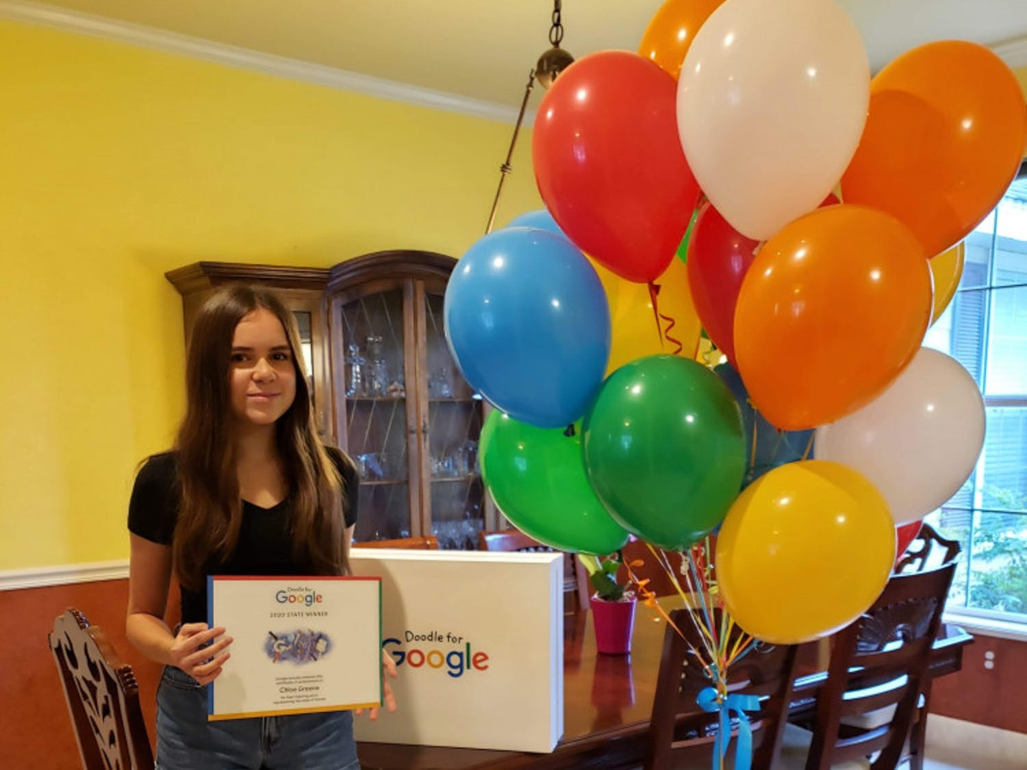Fifteen-year-old Chloe Greene, Florida's Doodle for Google finalist, was celebrated with two Google prizes and balloons Aug. 15.
