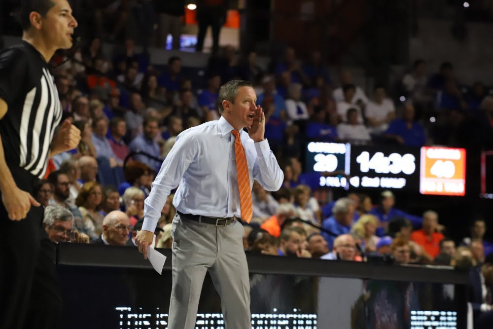 <p>Mike White yells calls during a game during the 2019-20 season.</p>