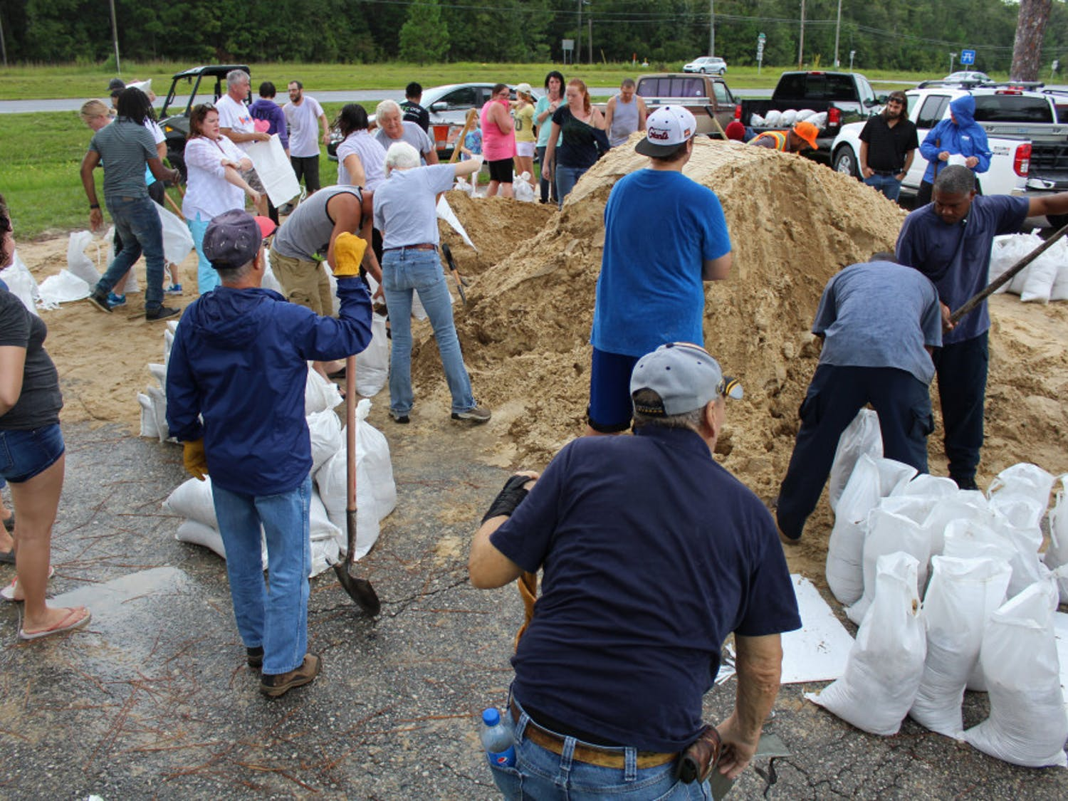 Alachua County residents work to fill sandbags to prepare for Hurricane Irma. Irma is currently ranked as a Category 5 hurricane and projections see it heading toward Florida.