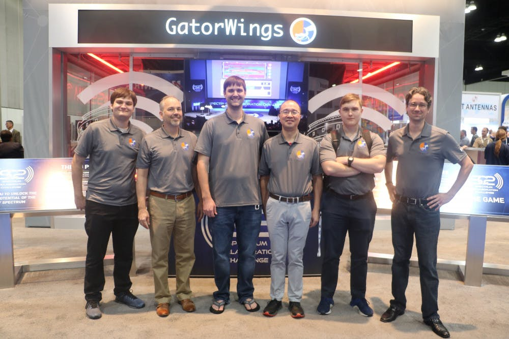 "<p>Team GatorWings (left to right: Marco Menendez, Dr. John Shea, Tyler Ward, Dr. Tan Wong, Caleb Bowyer, and David Greene). Photo emailed to me from John Shea.</p><div class=""yj6qo""> </div>"