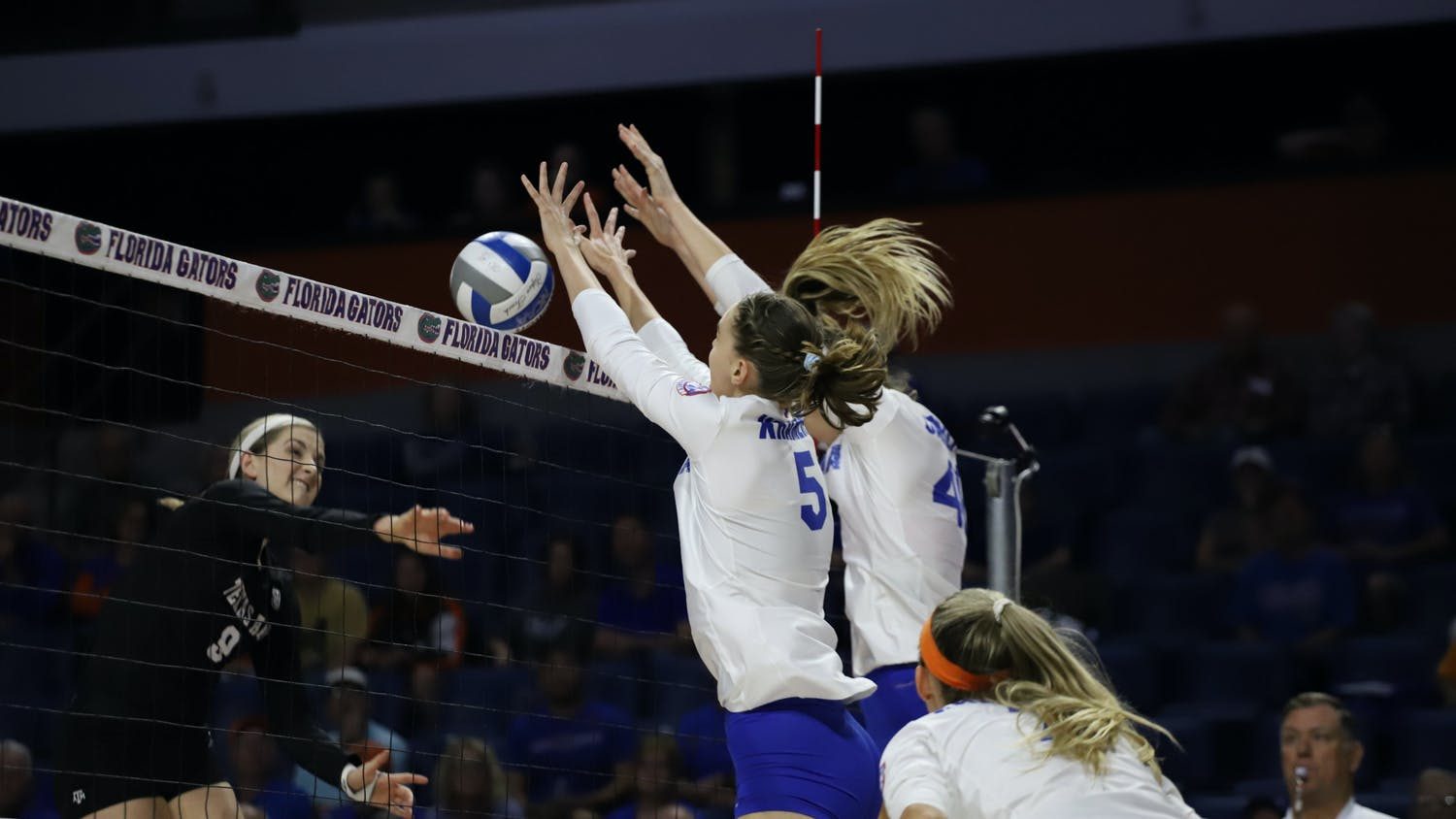 Florida's Rachel Kramer and Holly Carlton go for a block in a 2019 game against Texas A&M.