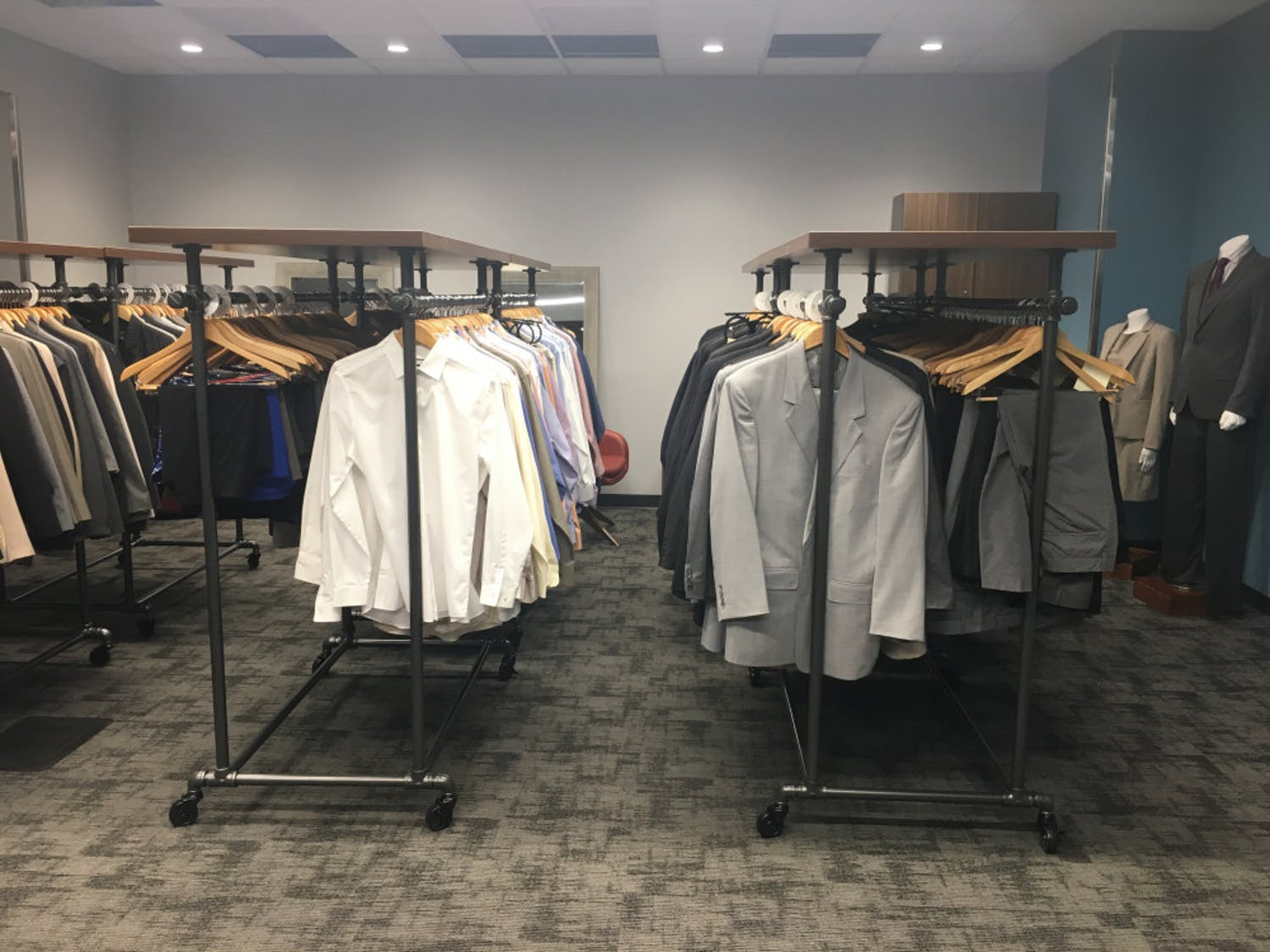 Career Connections Center staff are renovating the new space for the Gator Career Closet. The new space will have a larger selection of business attire for students.