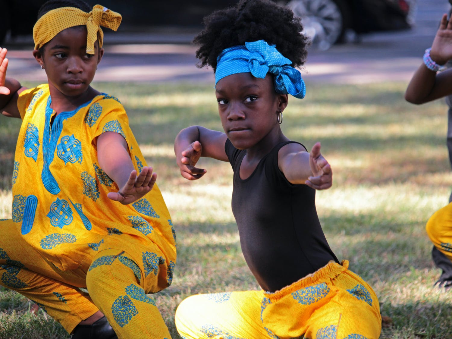 Laila Stanley (center) and her Caring and Sharing Learning School classmates perform a dance at the unveiling of a historical marker at the Alachua County Administration Building on Saturday, Oct. 23, 2021.
