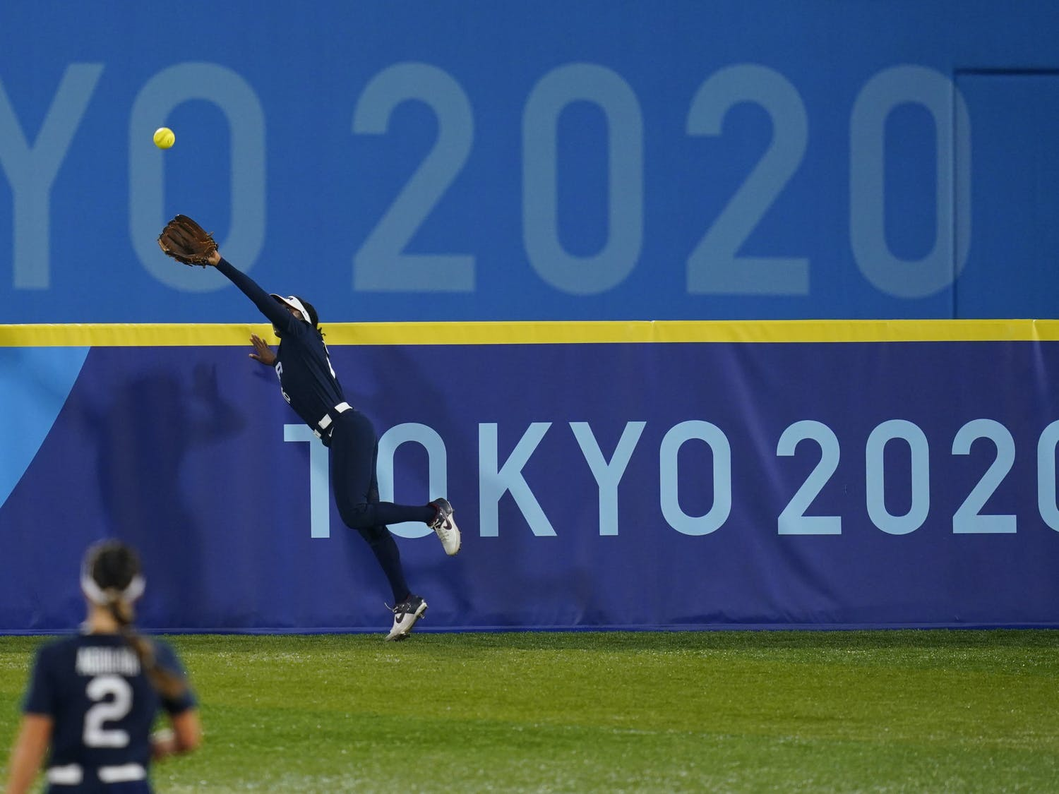 United States' Michelle Moultrie catches a fly out during a softball game against Japan at the 2020 Summer Olympics, Tuesday, July 27, 2021, in Yokohama, Japan. (AP Photo/Matt Slocum)
