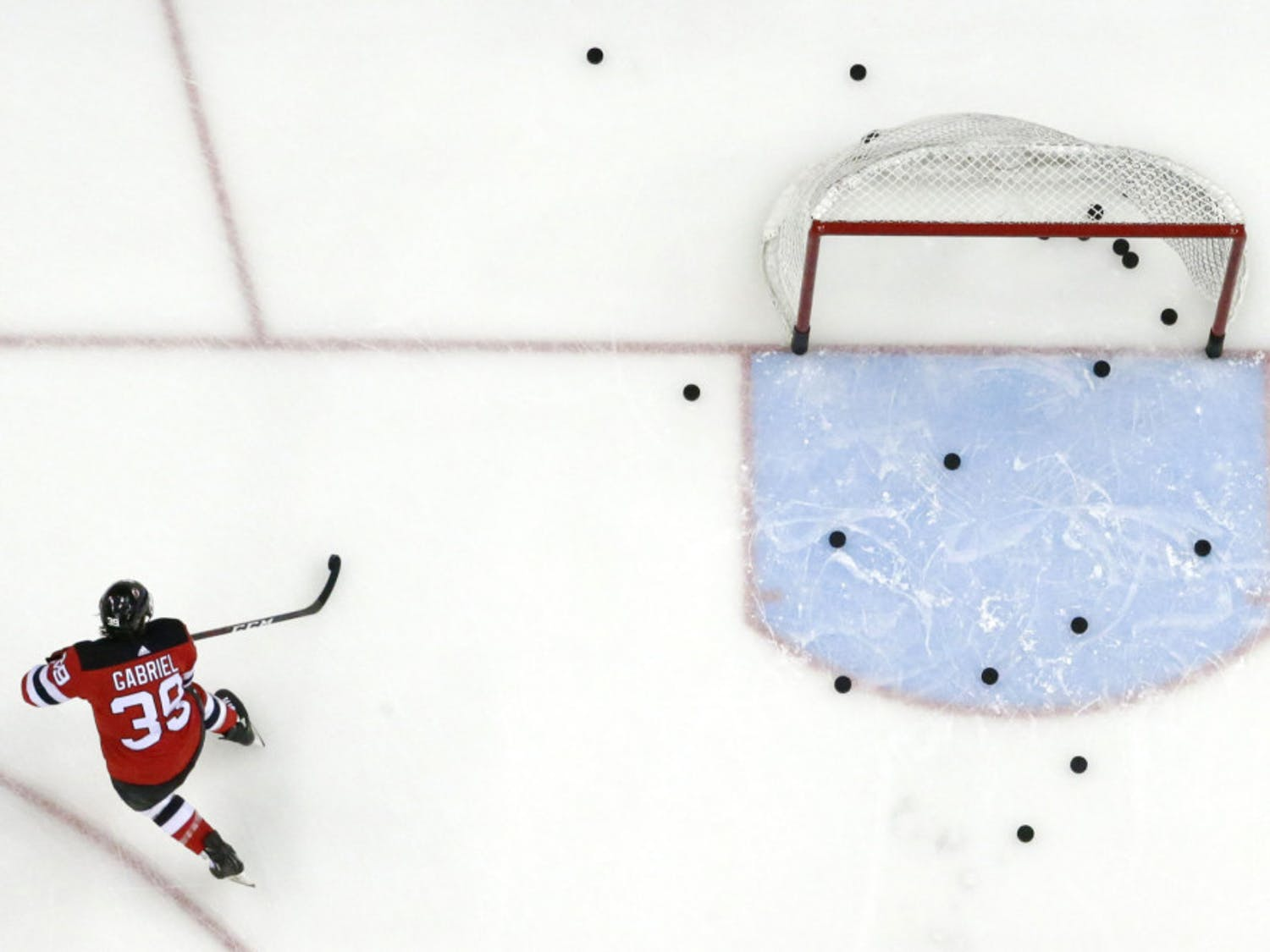 FILE - In this Feb. 17, 2019, file photo, New Jersey Devils right wing Kurtis Gabriel works out prior to an NHL hockey game against the Buffalo Sabres in Newark, N.J. The NHL is hoping to move to Phase 2 of its return-to-play protocol, including the opening of practice facilities and allowing small group workouts, early next month. The league, which was forced to pause its season on March 12 because of the COVID-19 pandemic, released a 22-page memo detailing the plan Monday, May 25, 2020. The document stresses there's no exact date for the start of Phase 2 or a timetable for how long it will last. (AP Photo/Julio Cortez, File)