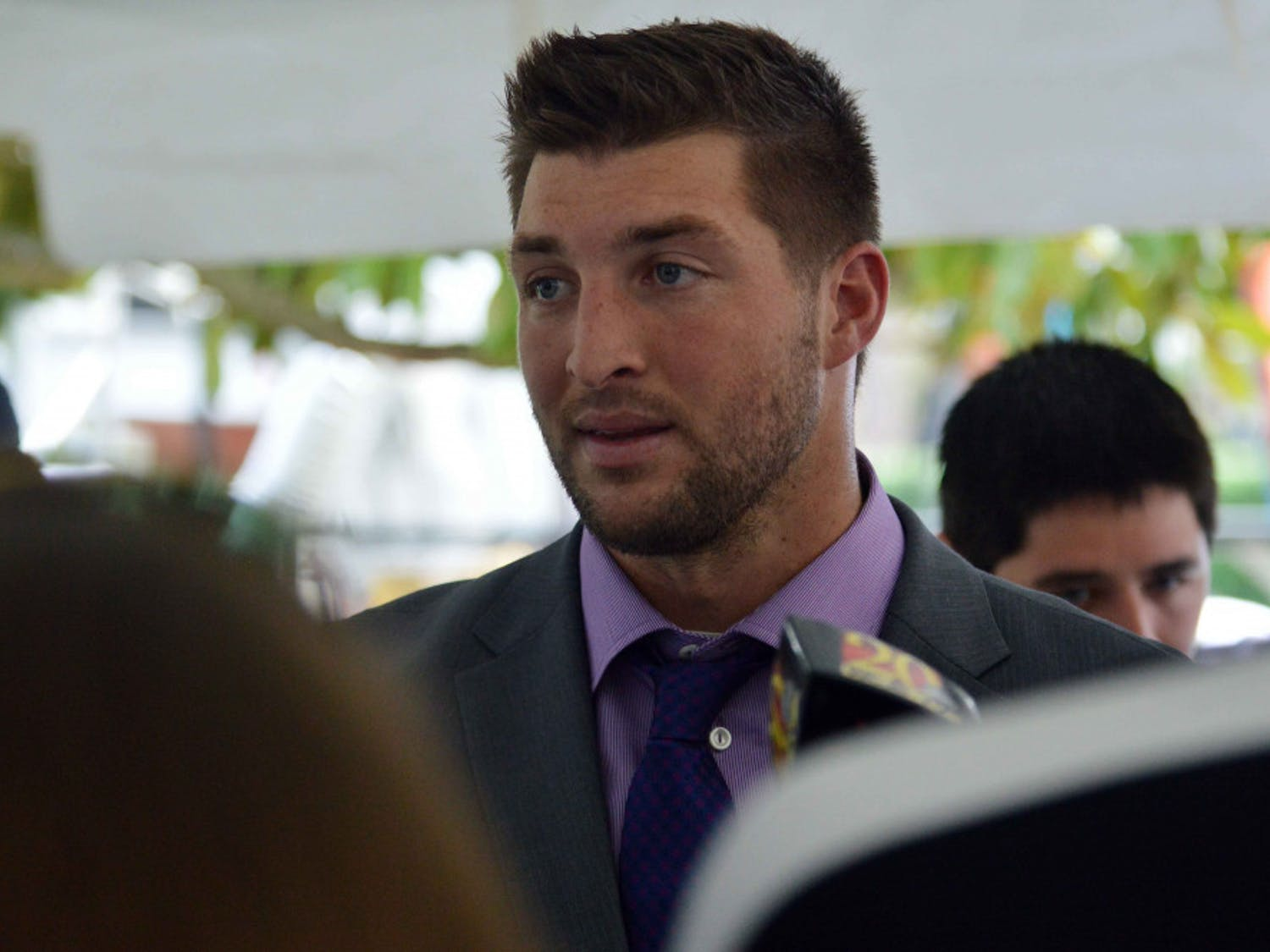 Former Florida quarterback Tim Tebow speaks with media on UF's Plaza of the Americas in September 2014.