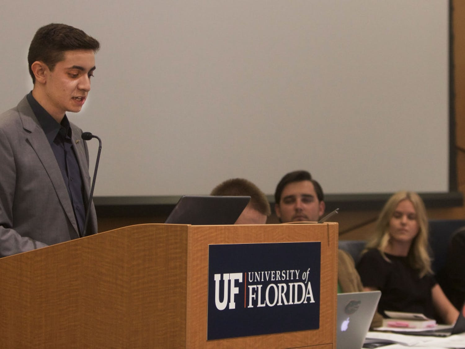 Mauricio Perez announces he is disaffiliating from the Impact Party during the final Student Government Senate meeting of the summer in the Reitz Union chamber room August 6.