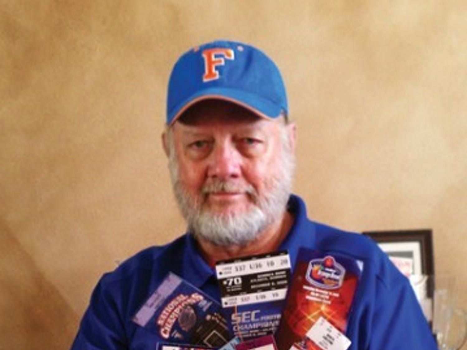 Don Crews shows off his UF football ticket stubs. On Saturday, he attended his 500th Gators football game.