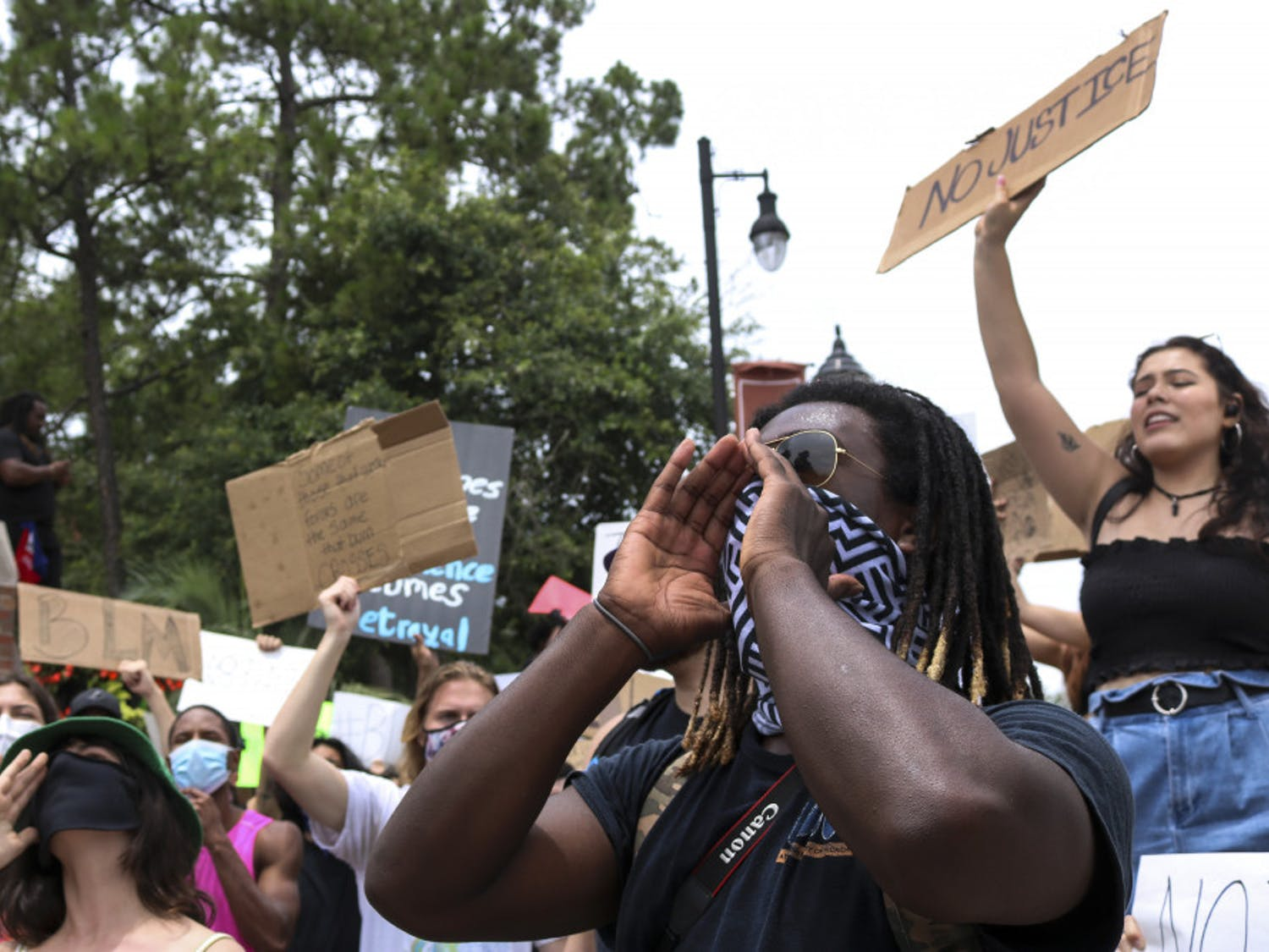 Morris McFadden, a 21-year-old telecommunications and production major and one of the organizers of the protest, shouts with the crowd of about 100 people June 3 at the intersection of 13th Street and University Avenue as part of a protest against police brutality.