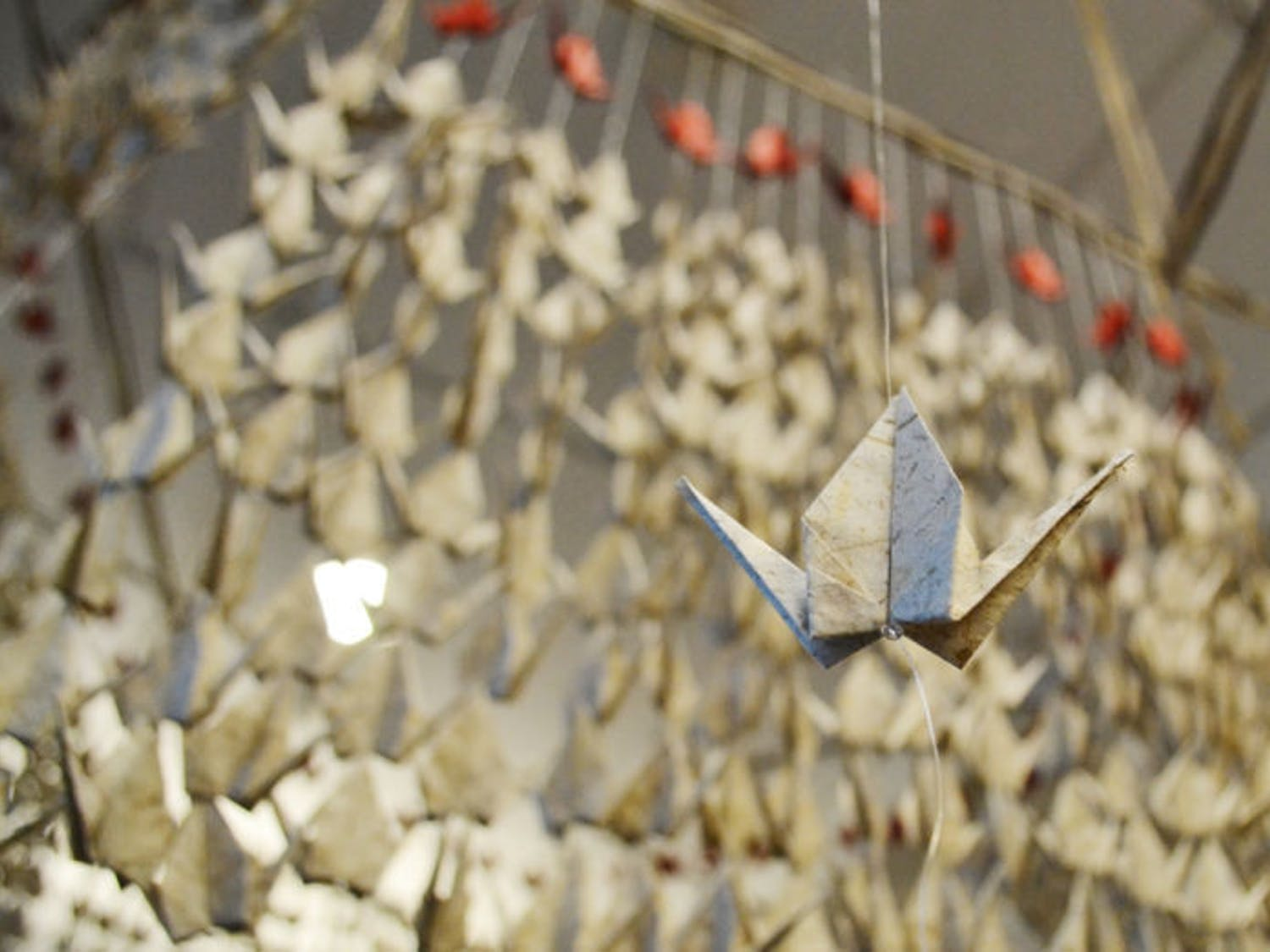 """Red paper cranes hang from the ceiling of UF Health Shands Cancer Hospital on Thursday for an art exhibit, """"Messages,"""" created by Elif Ackali, artist and UF associate professor of industrial and systems engineering ."""
