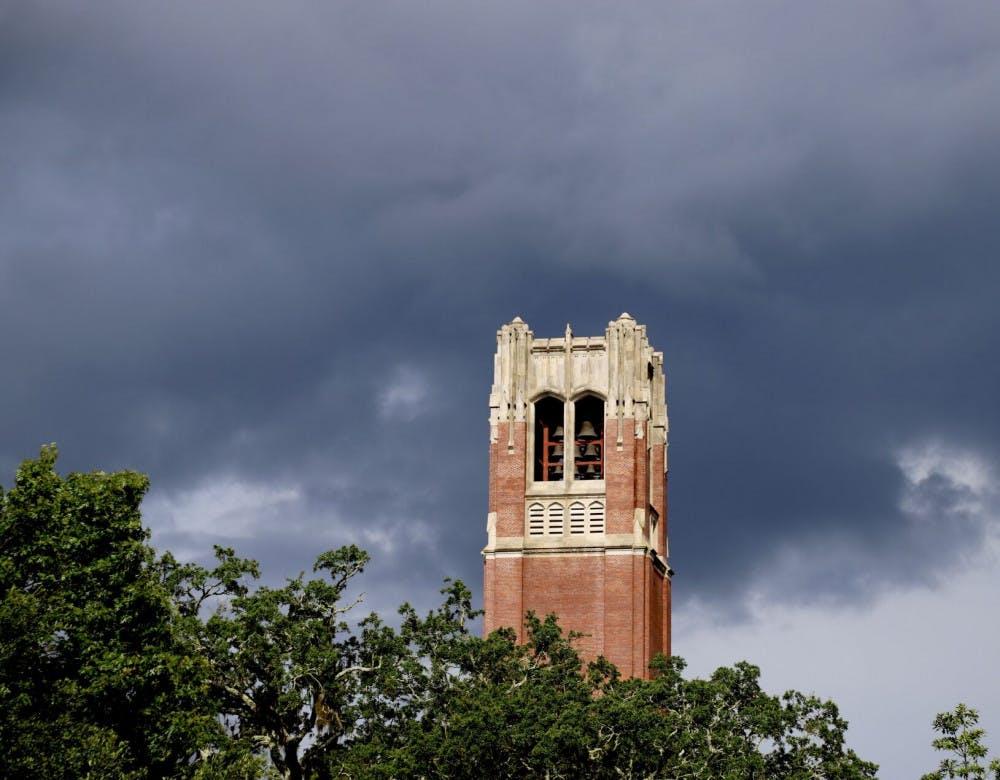 Photo of Century Tower with dark rain clouds behind it