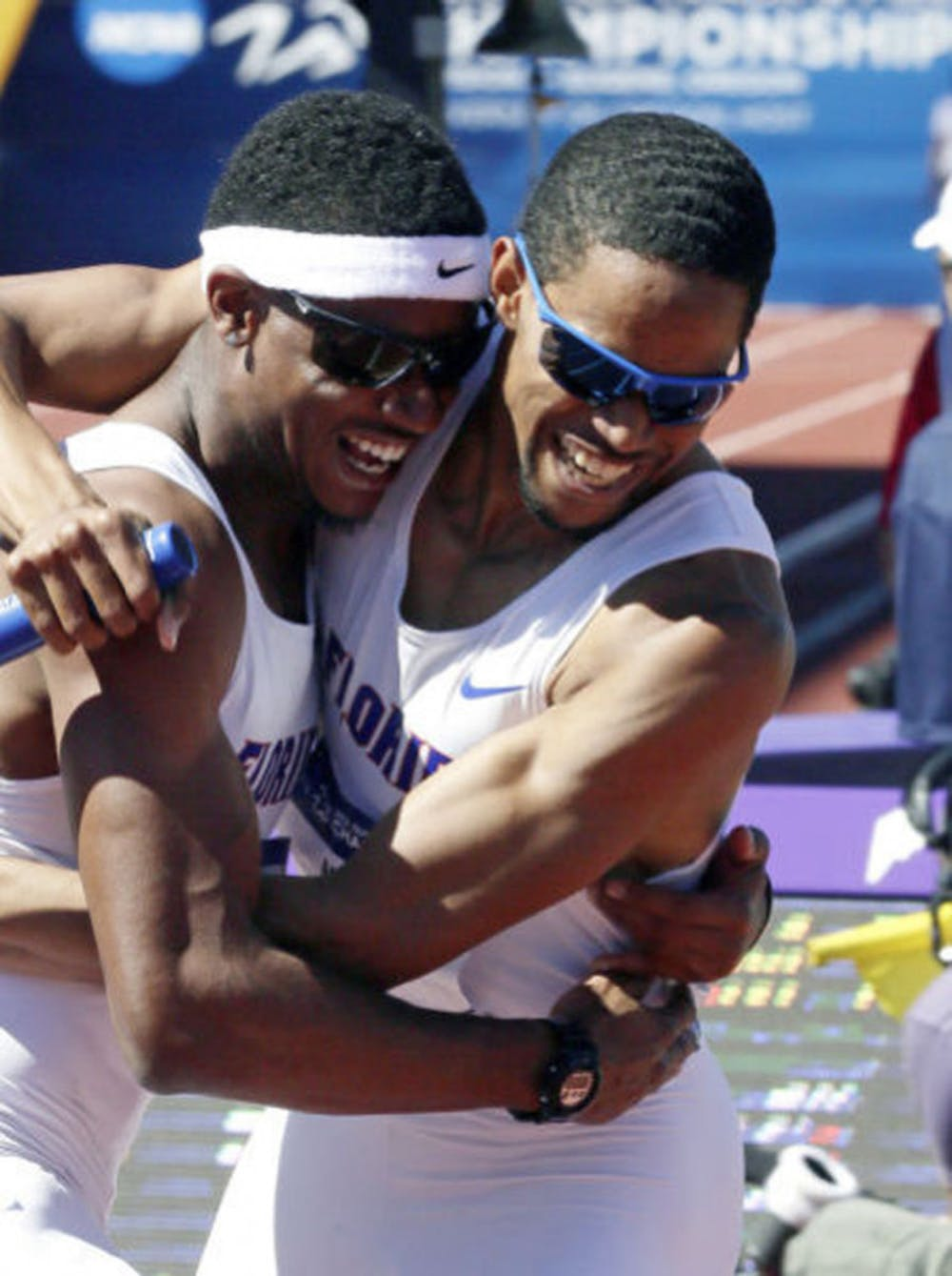 <p>Hugh Graham Jr. (left) hugs Arman Hall after winning the 4x400m relay during the NCAA Outdoor Championships in Eugene, Ore., on Jun. 8, 2013.</p>