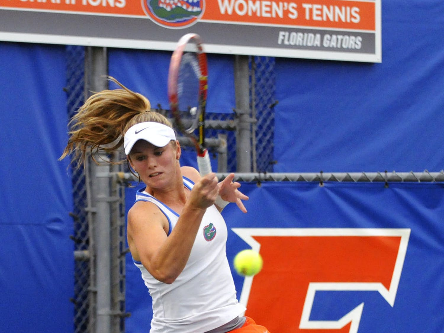 Belinda Woolcock returns a ball during Florida's win against South Florida on Jan. 27, 2017, at the Ring Tennis Complex.