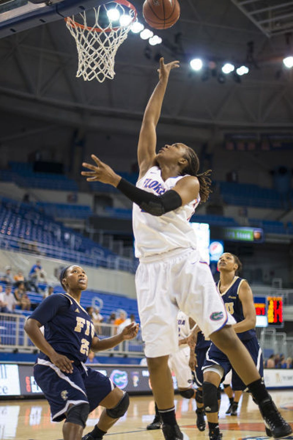 <p>Sophomore Christin Mercer scores two of her career-high 31 points on a layup during Florida's 90-74 win over FIU on Dec. 21 at the O'Connell Center. The Gators claimed their fourth straight Gator Holiday Classic championship.</p>
