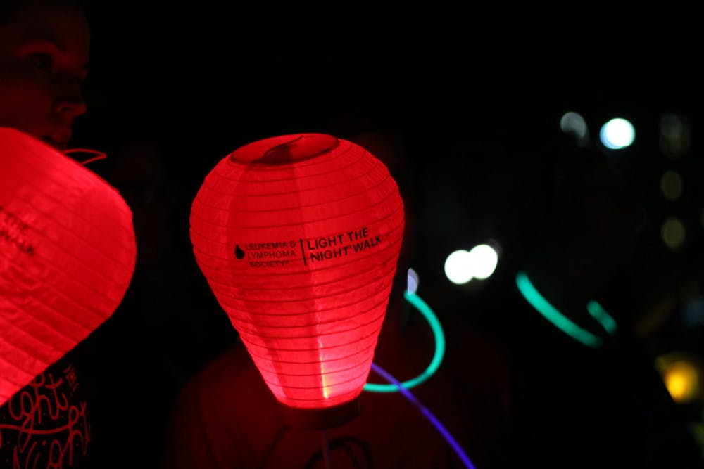 """<p><span id=""""docs-internal-guid-1ce160c2-4c7a-5ac3-546b-64115697c275""""><span>A red lantern, representing supporters of those who've had cancer of the blood, lights up the north lawn of Ben Hill Griffin Stadium during the Light the Night walk on Wednesday night.</span></span></p>"""