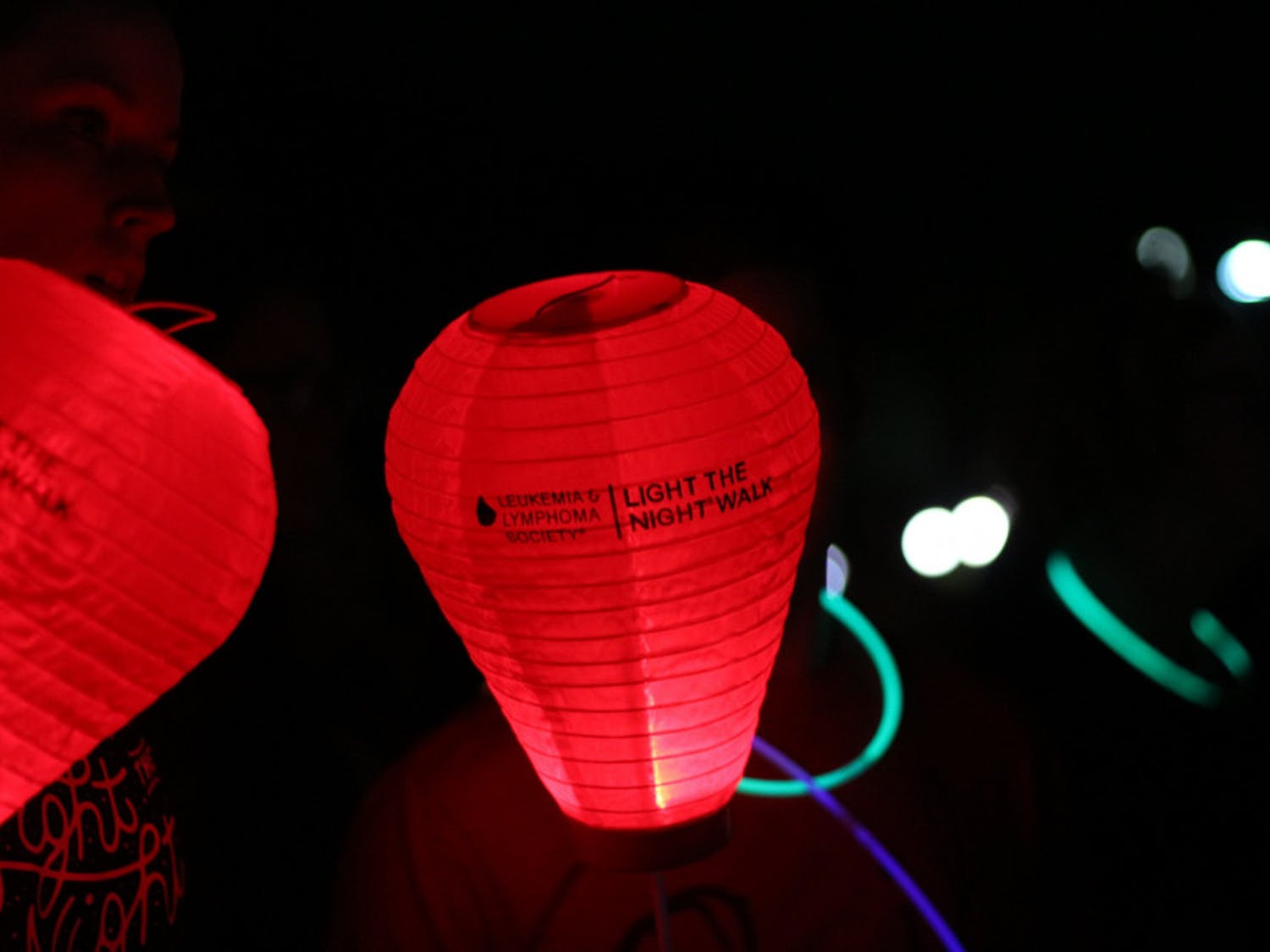 A red lantern, representing supporters of those who've had cancer of the blood, lights up the north lawn of Ben Hill Griffin Stadium during the Light the Night walk on Wednesday night.