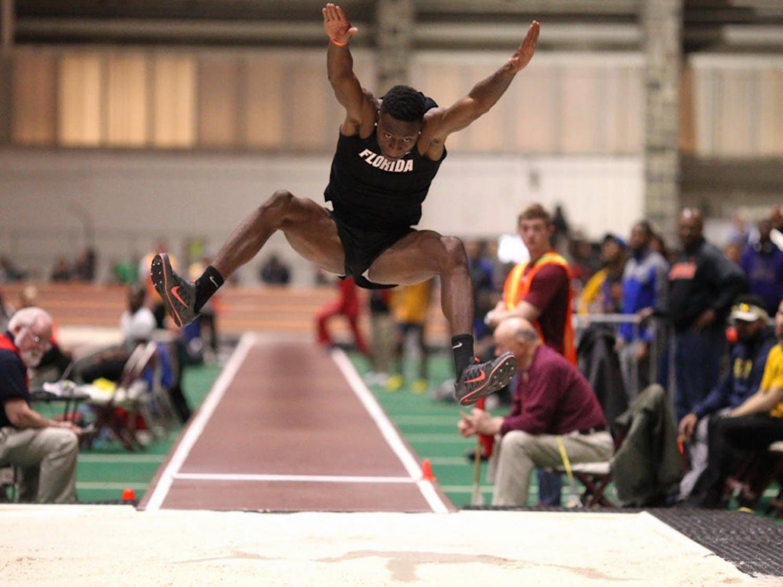 UF freshman Grant Holloway jumps at the Hokie Invitational men's long jump final on Jan. 21, 2017.