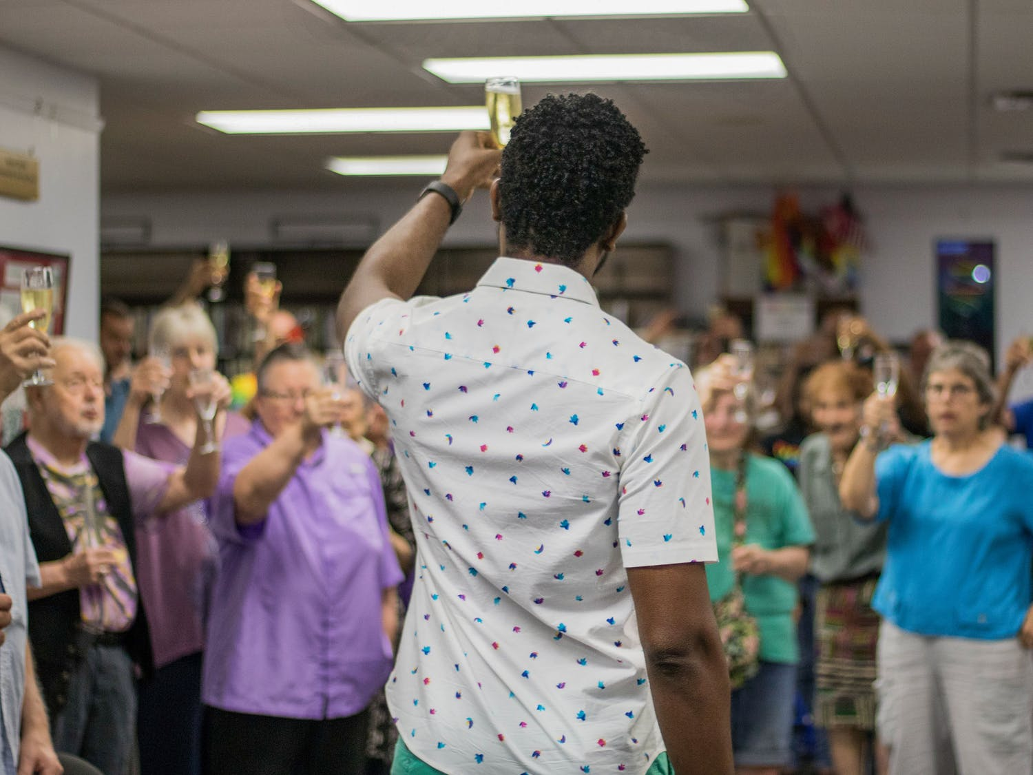 James Brown, 34, raises his glass Saturday night in a toast to the 50th anniversary of the Stonewall Riots and the progress the LGBTQ+ community has made during the Building on Our History Stonewall 50 Celebration party organized by the Pride Community Center of North Central Florida. The toast came after three speakers talked about the past struggles of the LGBTQ+ community, the progress the community has made and how to move forward. Over 50 people attended the event which offered food, refreshments and music.