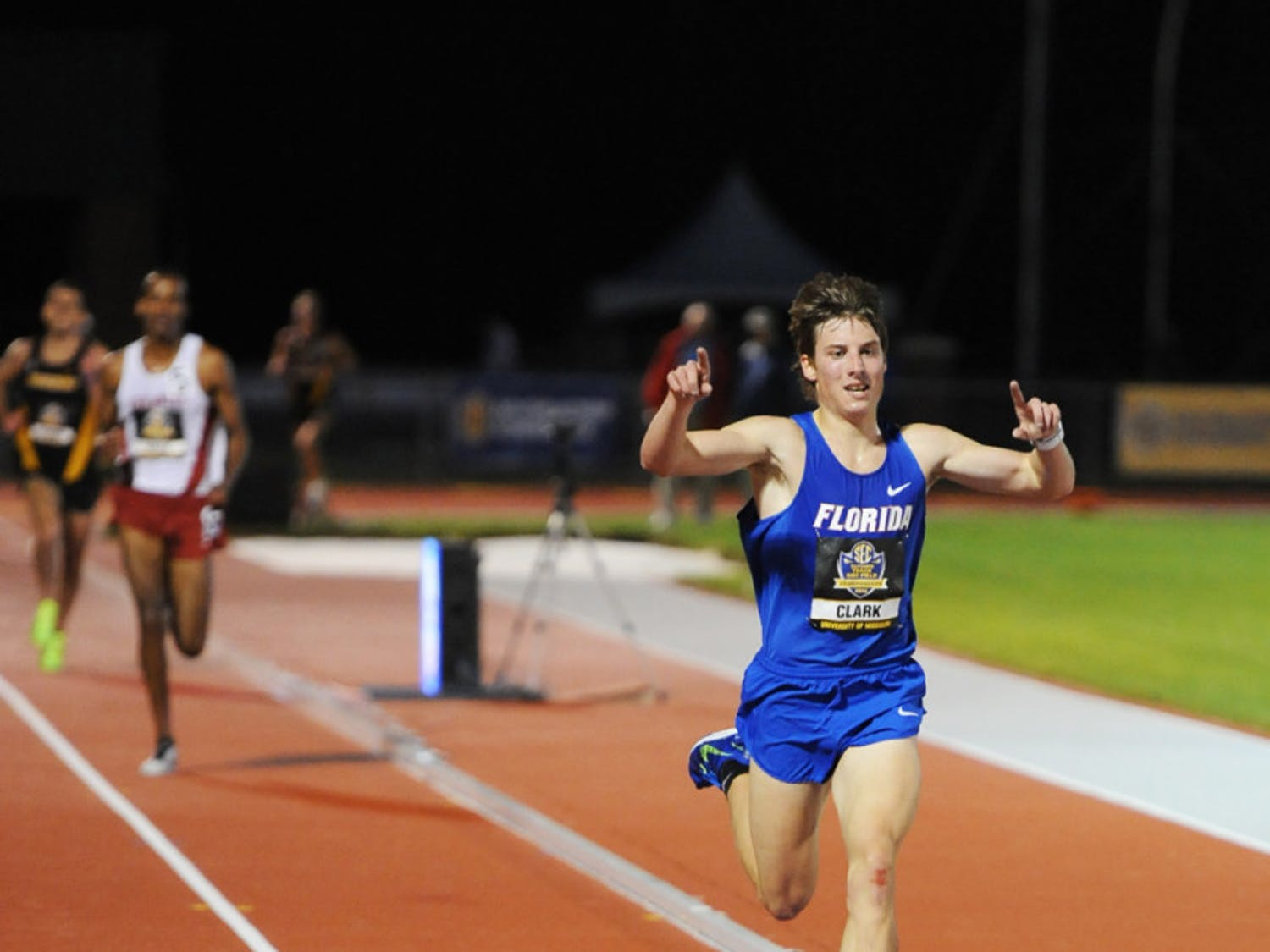 Jimmy Clark celebrates winning the men's 10,000-meter at the SEC Outdoor Championships in Columbia, Mo., on May 10. Clark was named SEC Men's Freshman Runner of the Year on Friday.