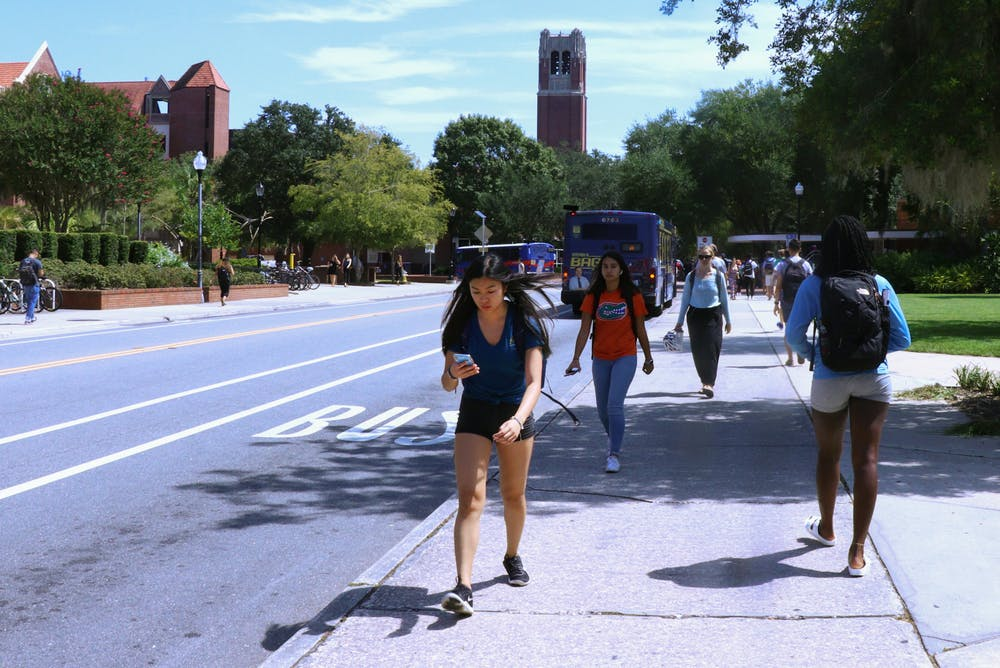 <p>University of Florida students rush to and from class along Stadium Road prior to the pandemic, on September 17, 2019. The upcoming fall semester will see tens of thousands of students return to campus, although an increase in the number of delta variant COVID-19 infections raises concerns about viral spread among unvaccinated people.</p>