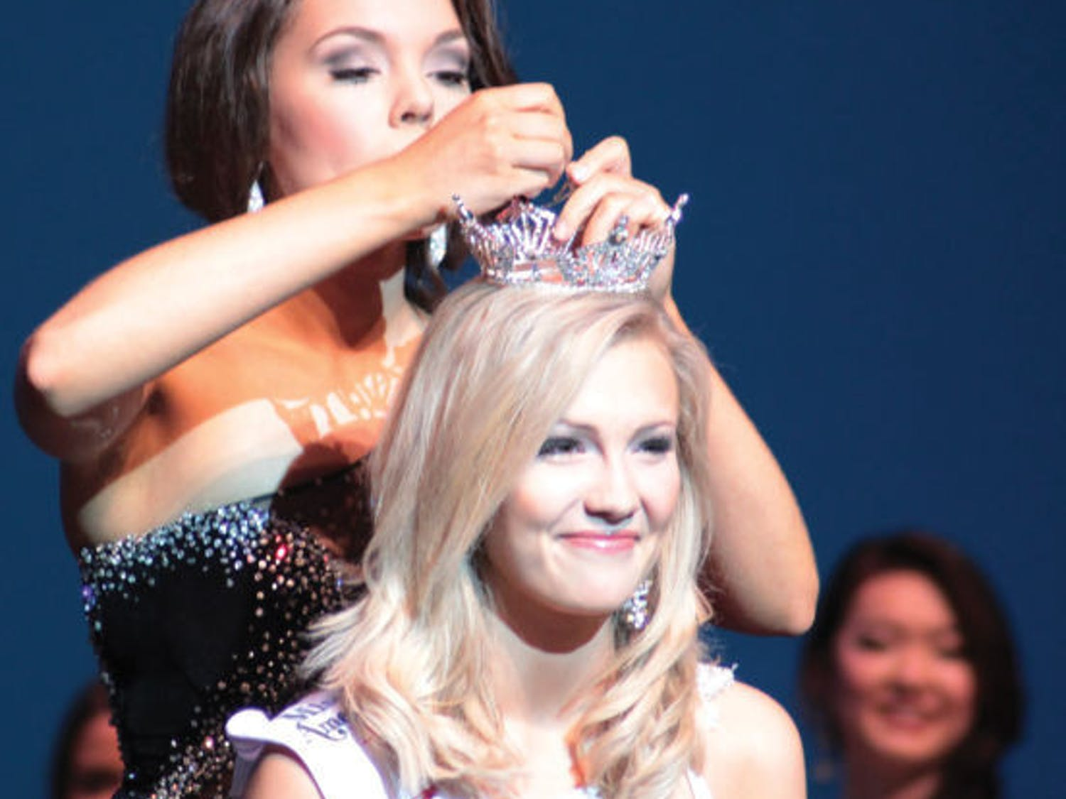Telecommunication sophomore Elizabeth Fechtel is crowned Miss UF 2014 at the Curtis M. Phillips Center for the Performing Arts on Monday night.