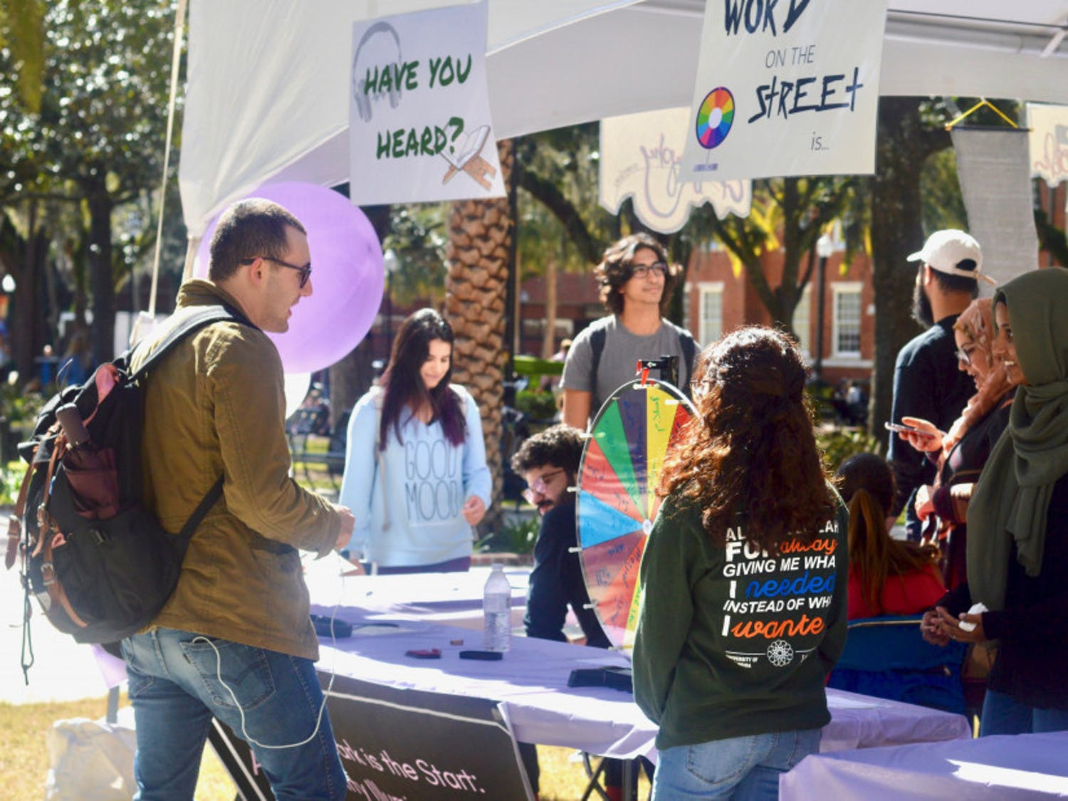 Students gather in Plaza of the Americas for UF's Islam on Campus' Islam Fair on Monday afternoon. The event featured free calligraphy, free, henna and free food, with the goal of educating students about Islam.
