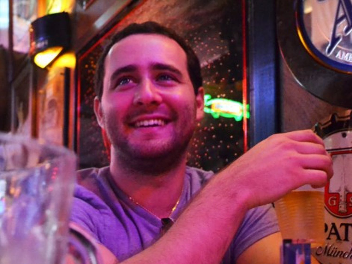 Senior Alex Solomon, enjoys a beer at Salty Dog Saloon before his class.