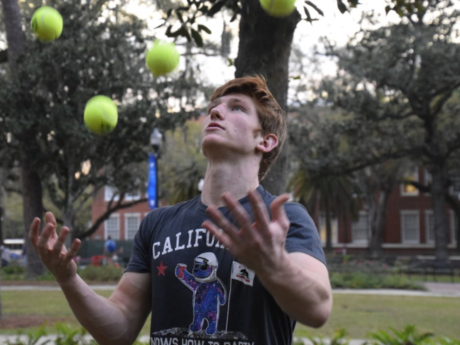 Devin Pryor, a 20-year-old UF aerospace engineering sophomore, juggles in front of Library West on Tuesday. It was one of his first meetings with UF Juggling Guys.