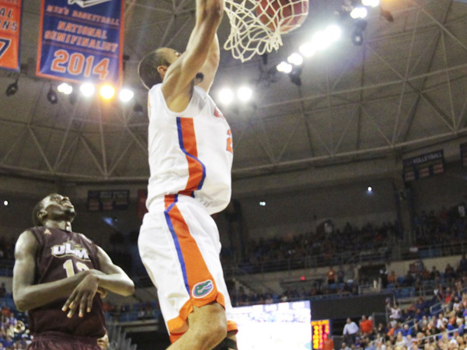 Jon Horford dunks during Florida's overtime win against Louisiana Monroe