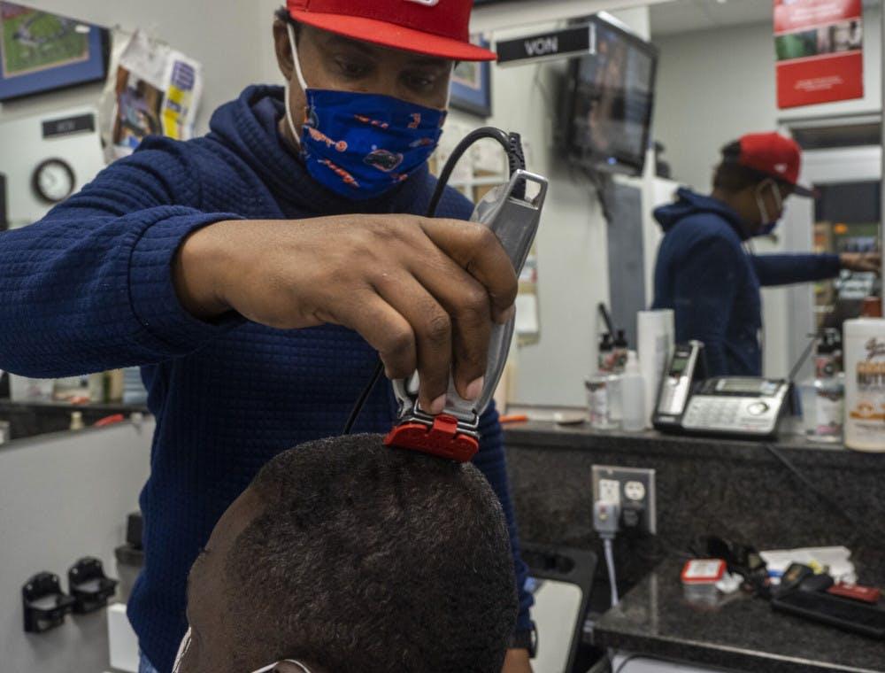 A picture of Von Brockington trimming hair