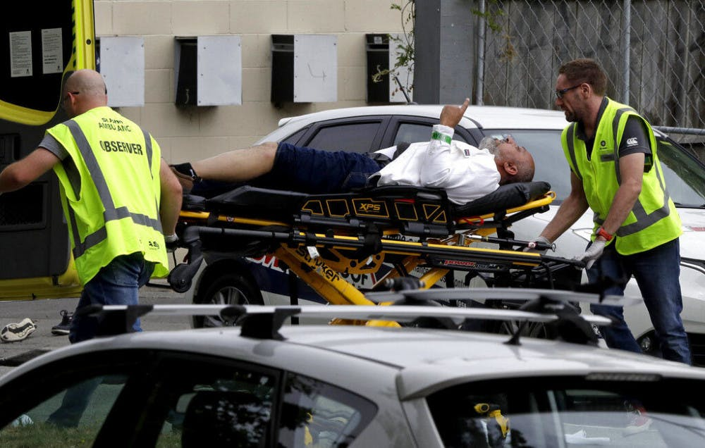 <p>Ambulance staff take a man from outside a mosque in central Christchurch, New Zealand, Friday, March 15, 2019. A witness says many people have been killed in a mass shooting at a mosque in the New Zealand city of Christchurch.(AP Photo/Mark Baker)</p>