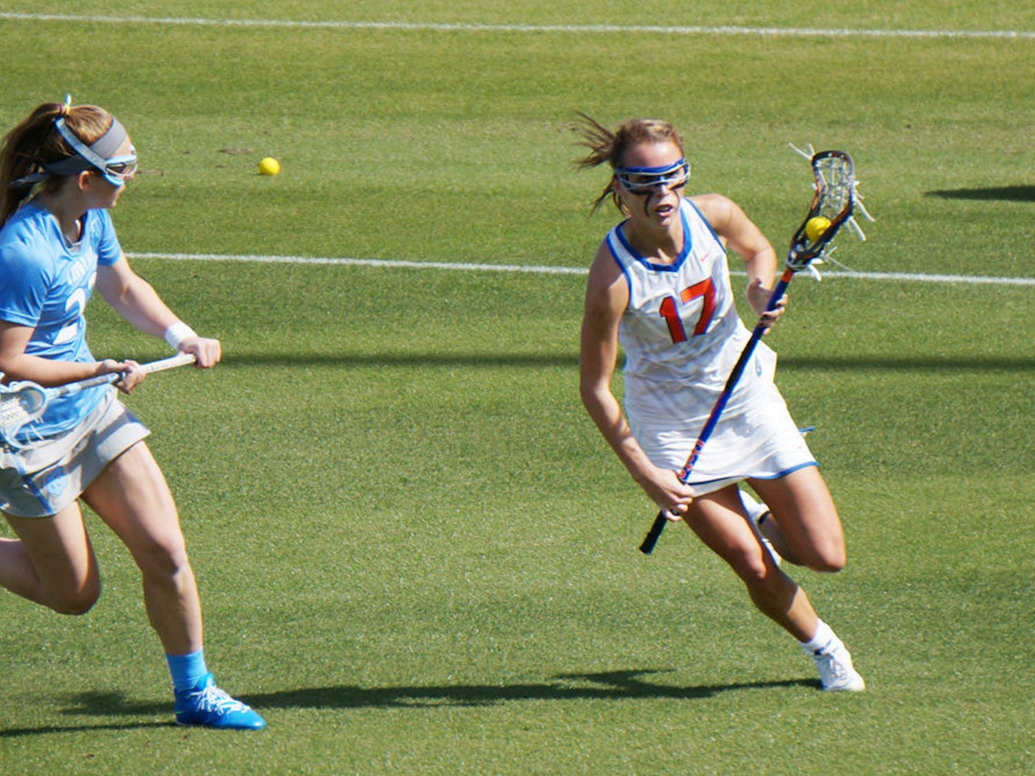 Mollie Stevens (17) runs down the field during UF lacrosse's season-opening loss to UNC on Feb. 7, 2015 at Donald R. Dizney Stadium.