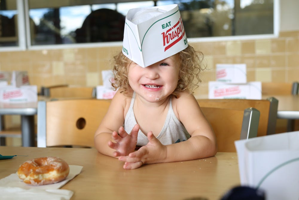 """<p dir=""""ltr"""">Tessa Reed, 2, smiles after eating a donut on Monday morning during the """"International Talk Like a Pirate Day"""" at Krispy Kreme. Throughout the day, anyone who dressed up like a pirate received a free box of donuts.</p>"""
