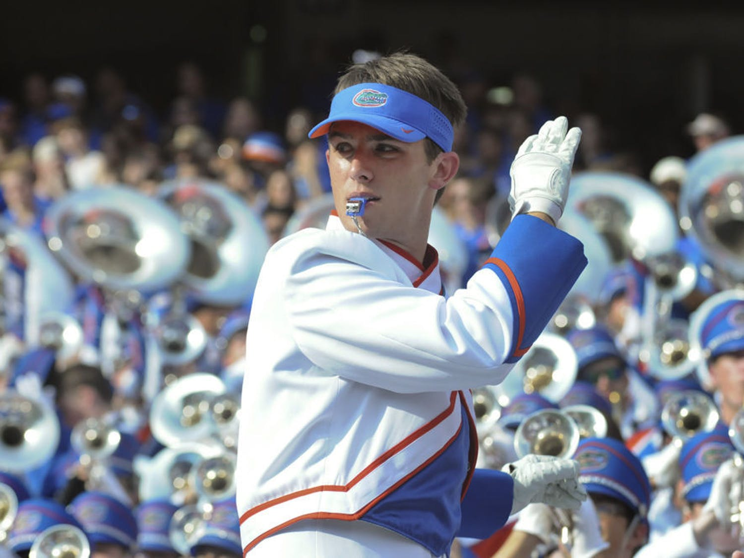 Ben Judkins conducts the Gator Band during UF's 38-10 win against Ole Miss on Oct. 3, 2015,at Ben Hill Griffin Stadium. The drum major has directed the 350-student band, along with two other drum majors, for two years.