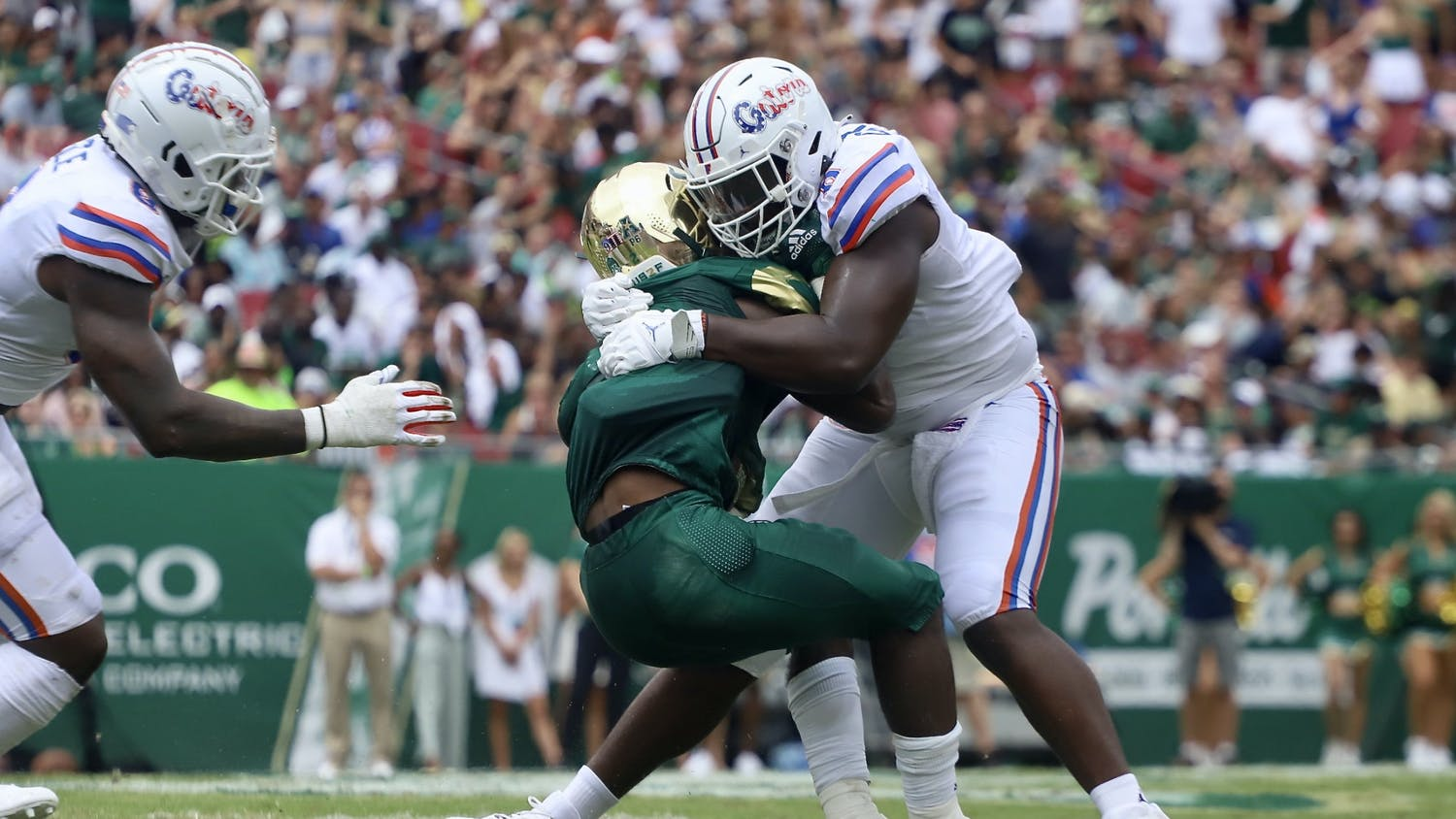 Florida defensive end Zachary Carter tackles a USF ball carrier on Sept. 11. Carter will look to add to his three sacks this season this Saturday versus Alabama.