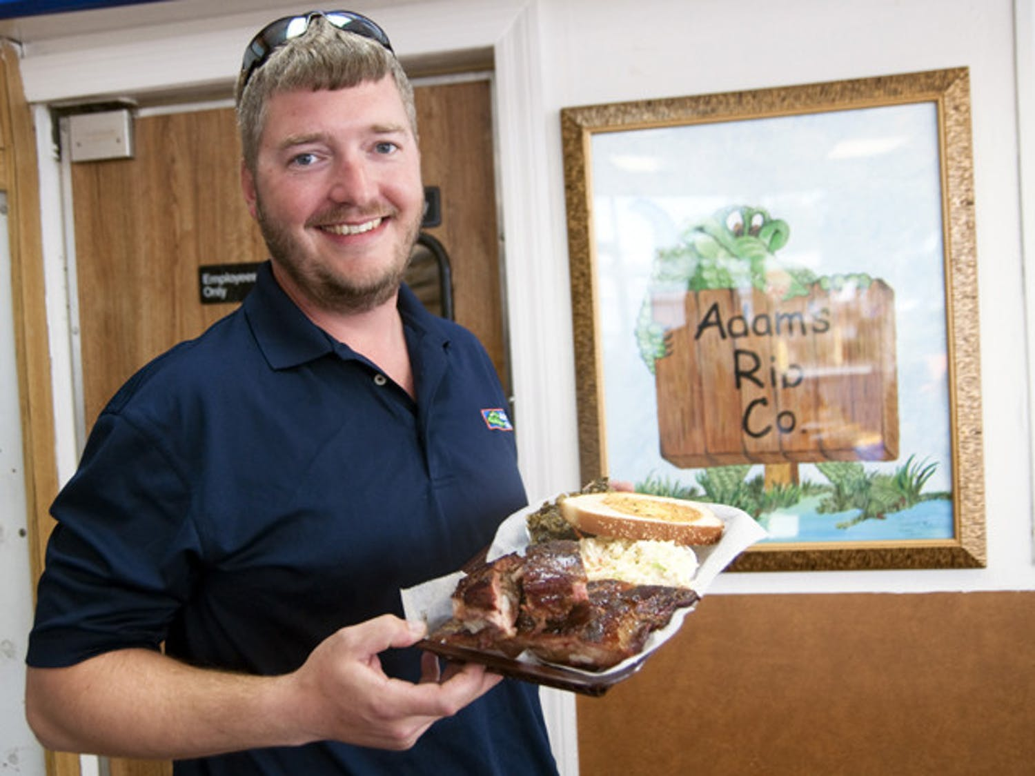 Gainesville native, Adam Brewer, shows off his pride and joy: perfect BBQ ribs.