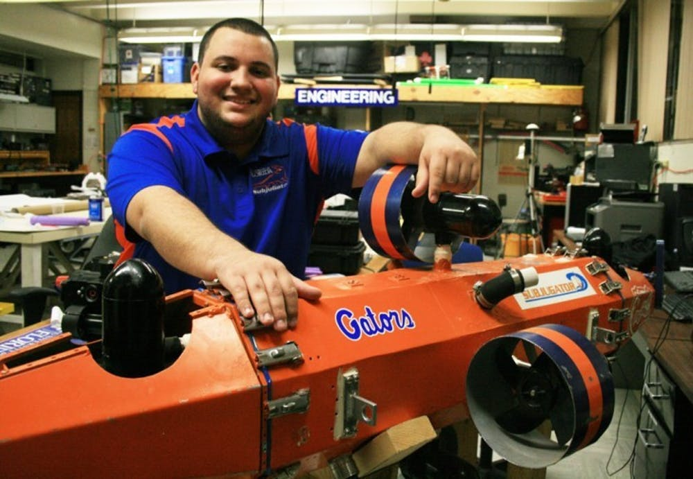 <p>Computer science senior Camilo Buscaron, 22, spends his days working with robots to prepare them for competitions. He and his team recently built the SubjuGator, which can to swim through underwater tubes without a remote control.</p>