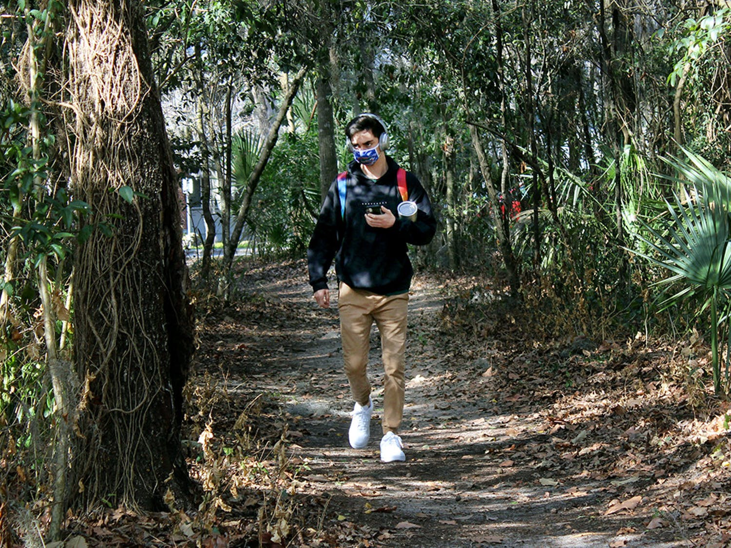 "Matt Raulerson, 20, a forest resources and conservation junior, walks on a path through the McCarty Woods Conservation Area on Thursday, Feb. 4, 2021. Raulerson expressed disappointment at the news that the conservation area has been approved as a possible future site for construction. ""It's horrible,"" he said. ""It would take away all the beauty of it. It's something I pass everyday I walk to class and it's something I love looking at."""