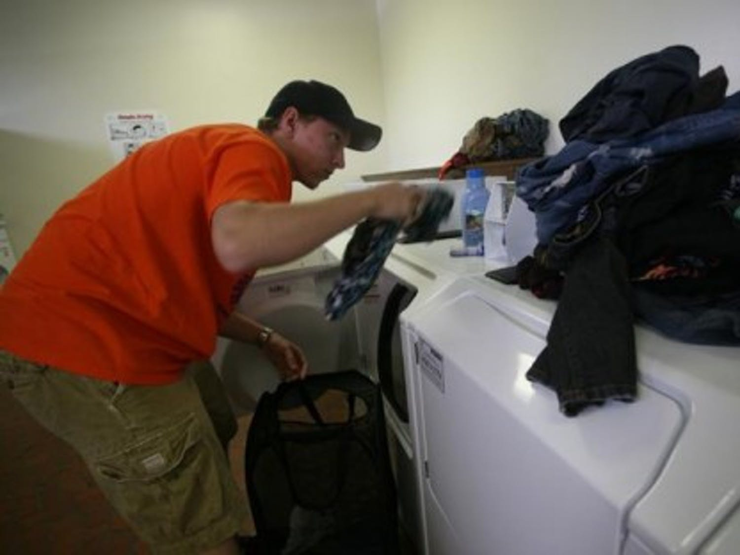 UF sophomore Chris Saunders separates his dark from his light clothes in the laundry room of Beaty Towers West on Thursday, Sept. 7, 2007.