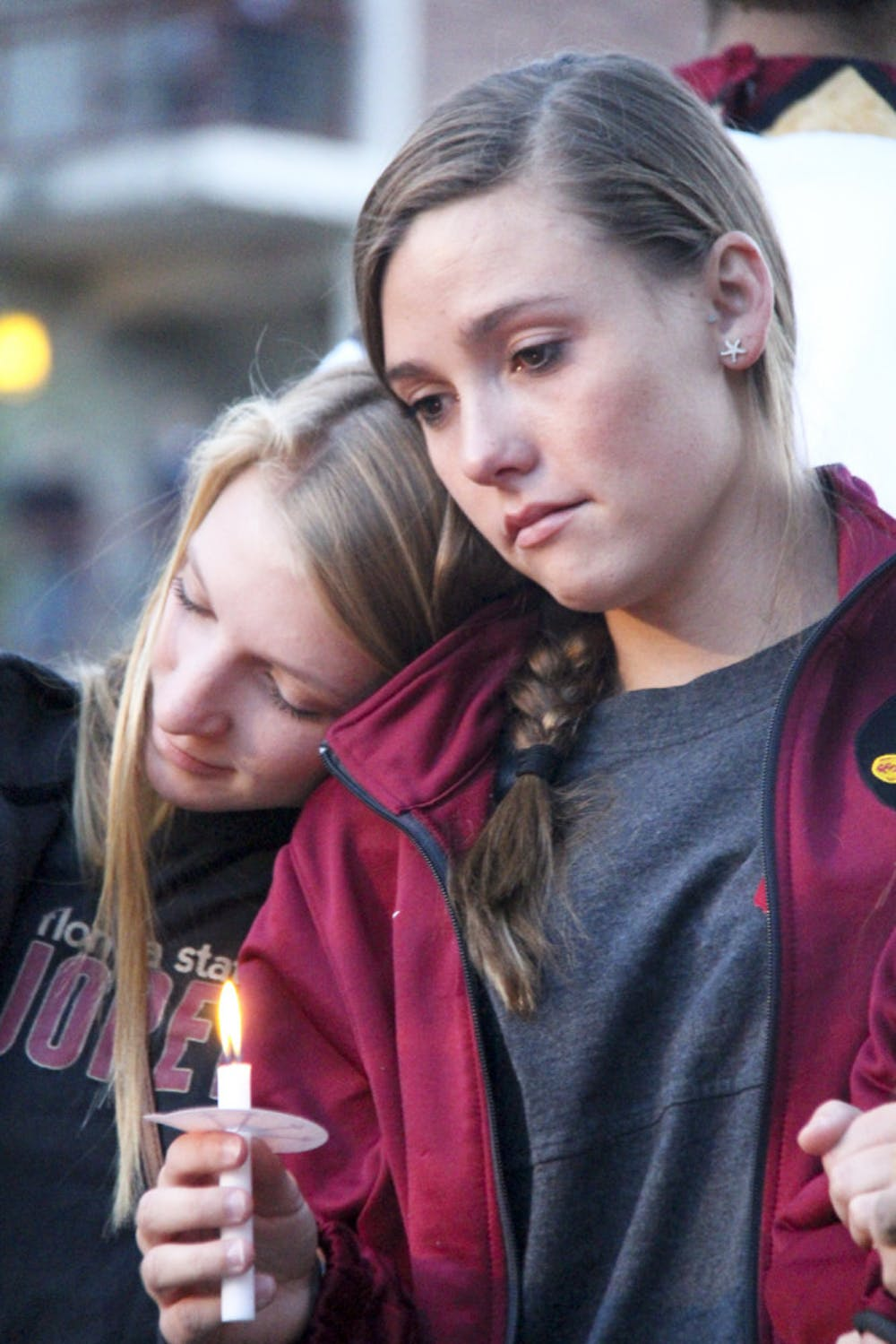 "<p class=""p1"">19-year-old FSU statistics freshman Olivia Heartsell, (left), leans on her teammate Amber Milner, a 22-year-old psychology junior, during the Gathering of Unity at the university's Integration Statue on Thursday evening.</p>"