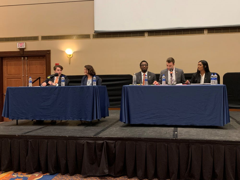 <p>Inspire (left) and Gator Party (right) executive candidates argued in their first Student Government debate.</p>