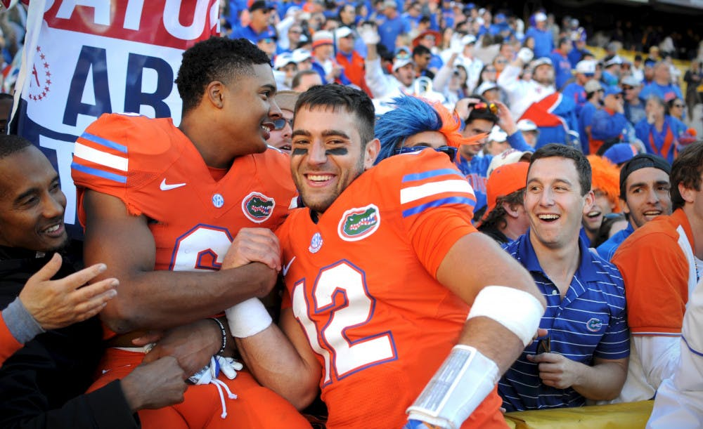 <p>Austin Appleby, right, celebrates with Quincy Wilson after Florida's 16-10 win against LSU on Nov. 19, 2016, at Tiger Stadium in Baton Rouge, Louisiana.</p>